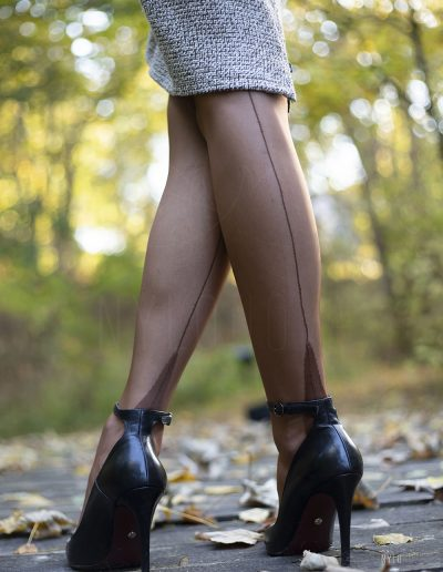 Mrs NyloNova wearing pencil skirt, copper coloured cuban heel Secrets in Lace nylon stockings. Black ankle strap high heels Ryłko.