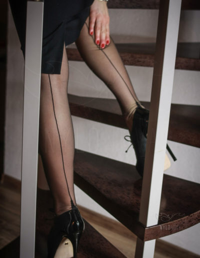 Mrs NyloNova wearing sky high Kazar high heels and sheer black Cervin nylon stockings