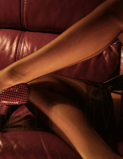 Mrs NyloNova wearing Gio point heel seamed nylon stockings, leather pencil skirt and Kazar high heels