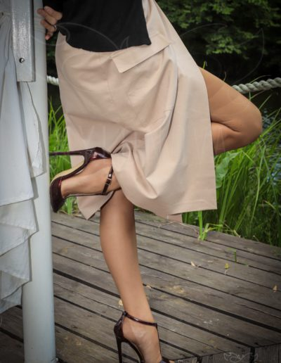 Mrs NyloNova wearing open front na-kd skirt, old vintage nylon ff stockings and Only Maker high heeled sandals.