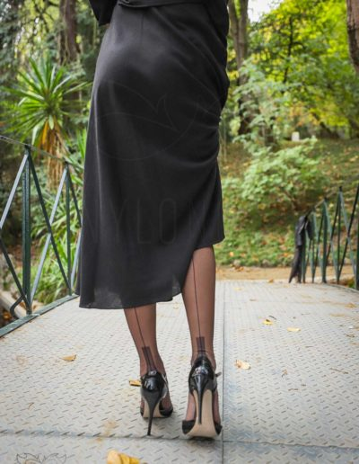Mrs NyloNova wearing long black dress, Gino Rossi high heels and sheer black seamed Cervin nylon stockings.